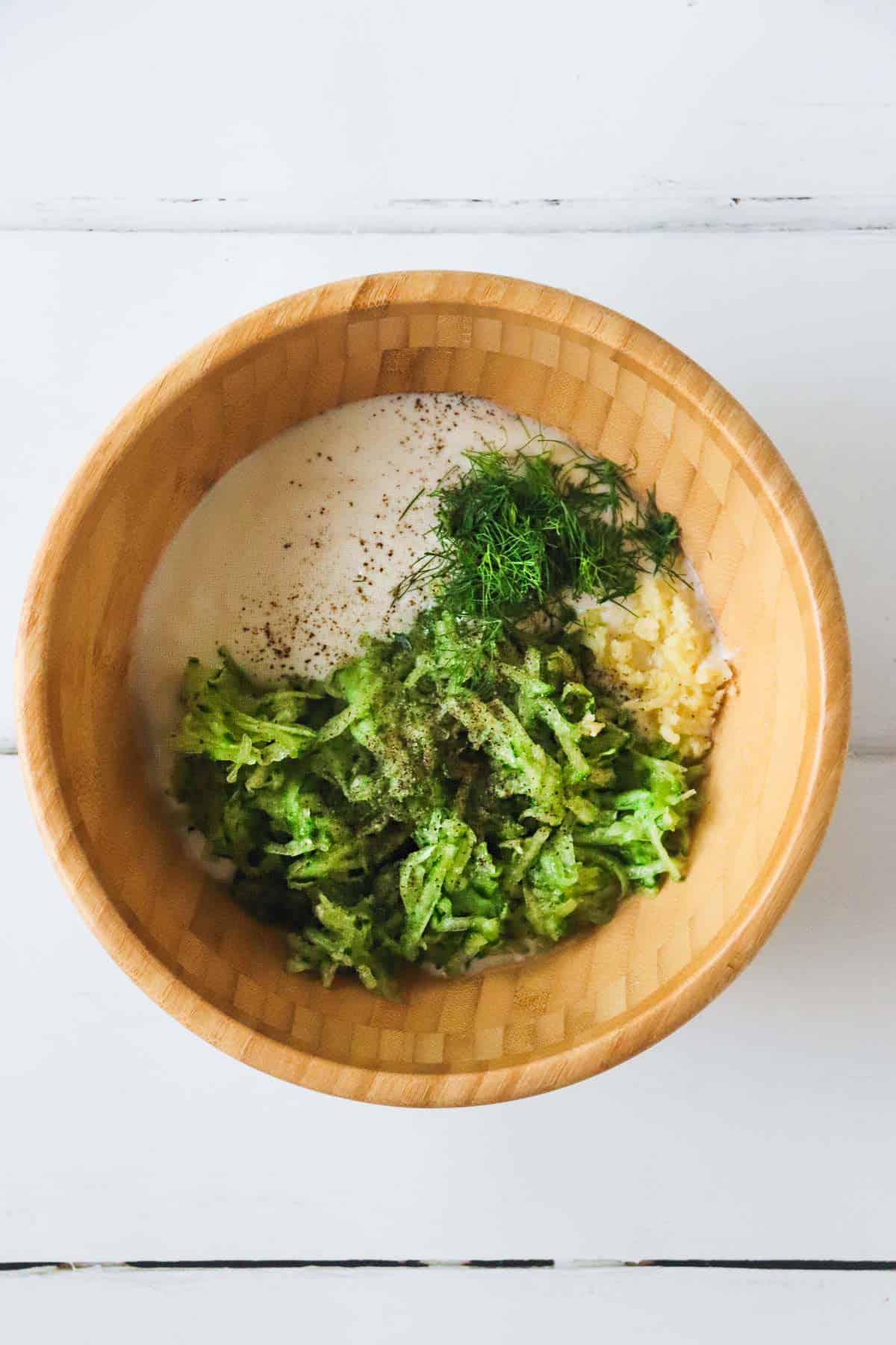 Vegan Tzatziki ingredients in a wooden mixing bowl