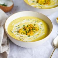 Curried cauliflower soup in a white bowl