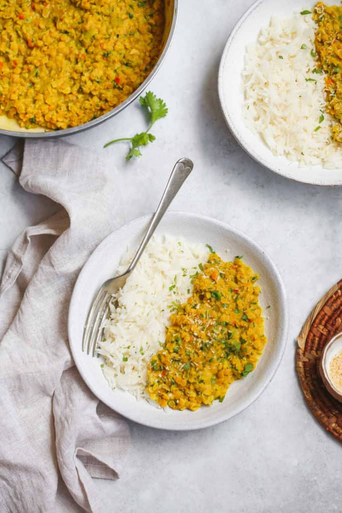 Lentil Dahl recipe served with white rice in white bowl