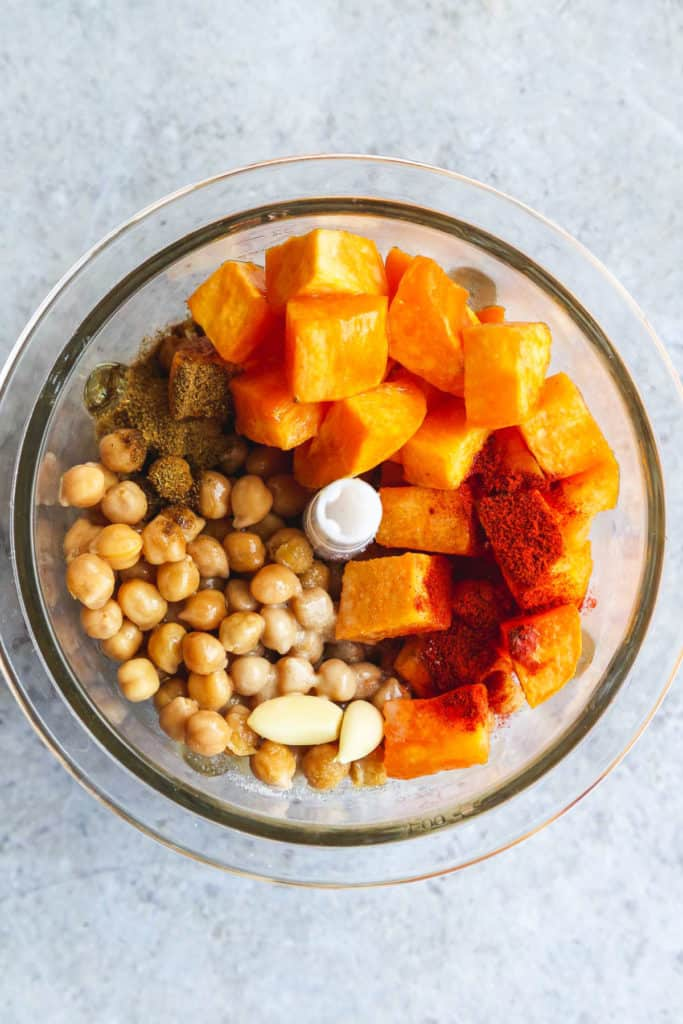 Sweet potato hummus ingredients in a food processor