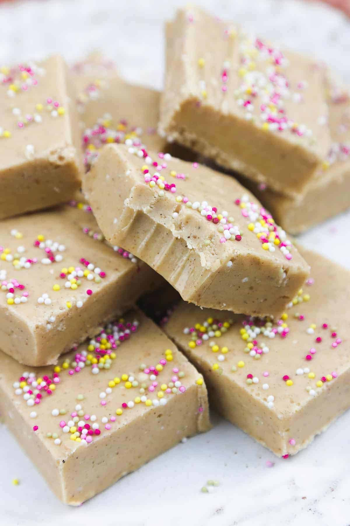 Condensed milk fudge squares piled on each other