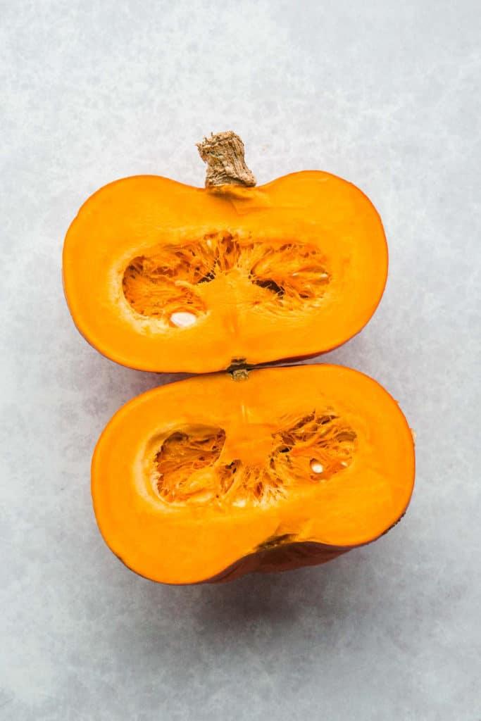 A pumpkin cut into two halves