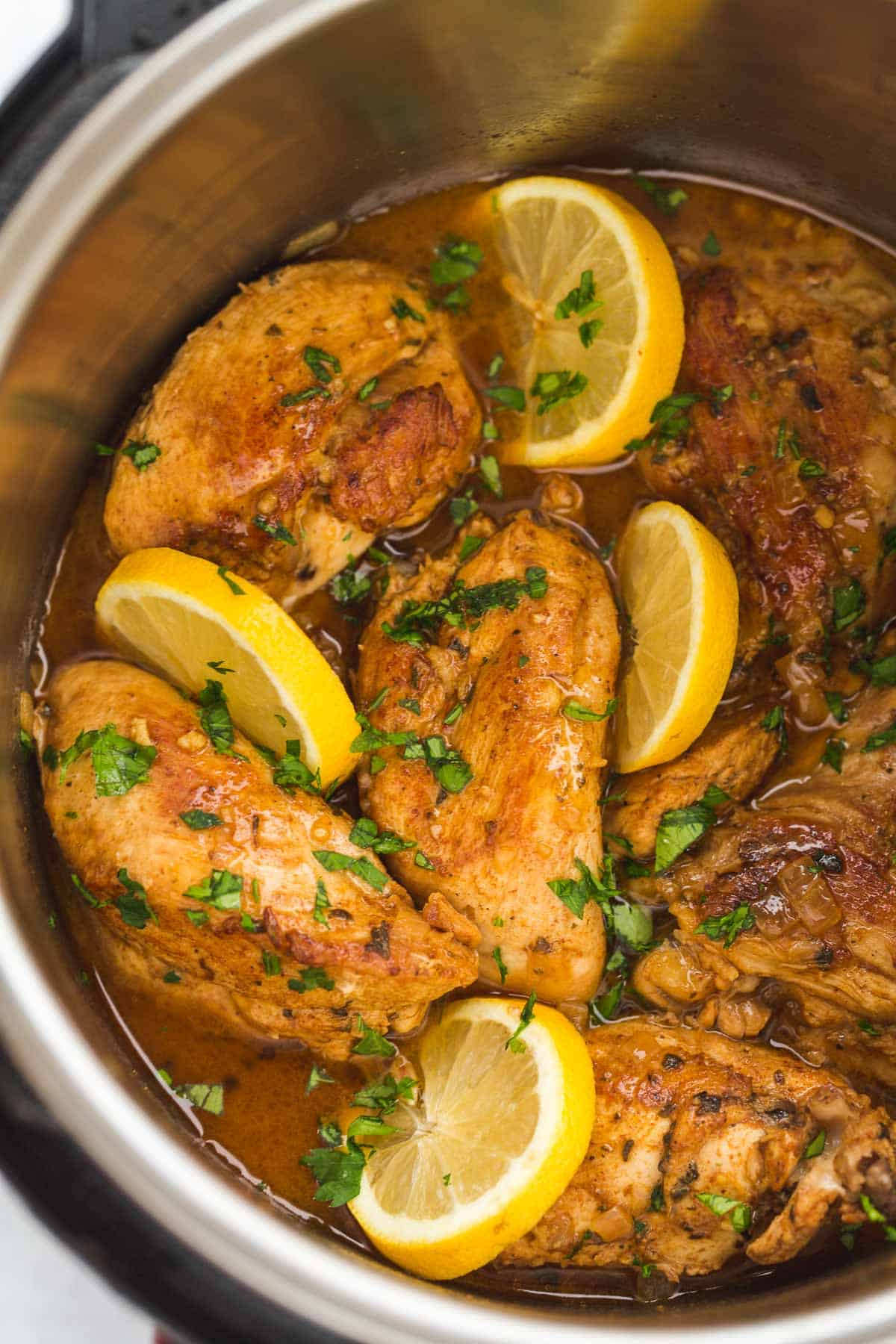 Lemon garlic chicken, and lemon slices in the Instant Pot