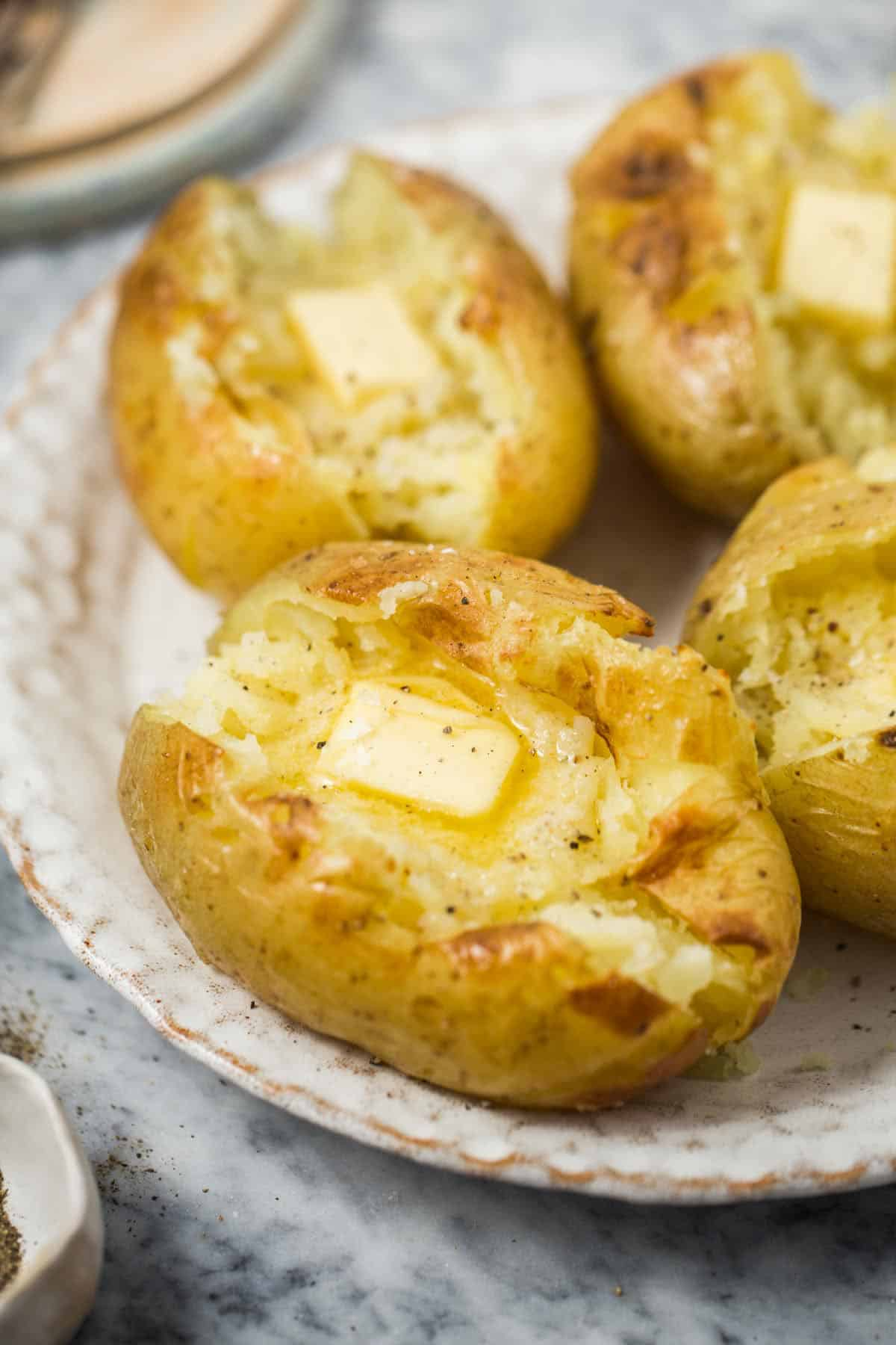 Instant Pot Baked Potatoes topped with butter