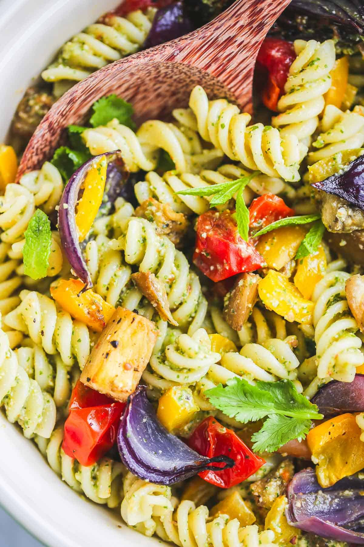 The colourful vegan pasta salad served in a large ceramic bowl
