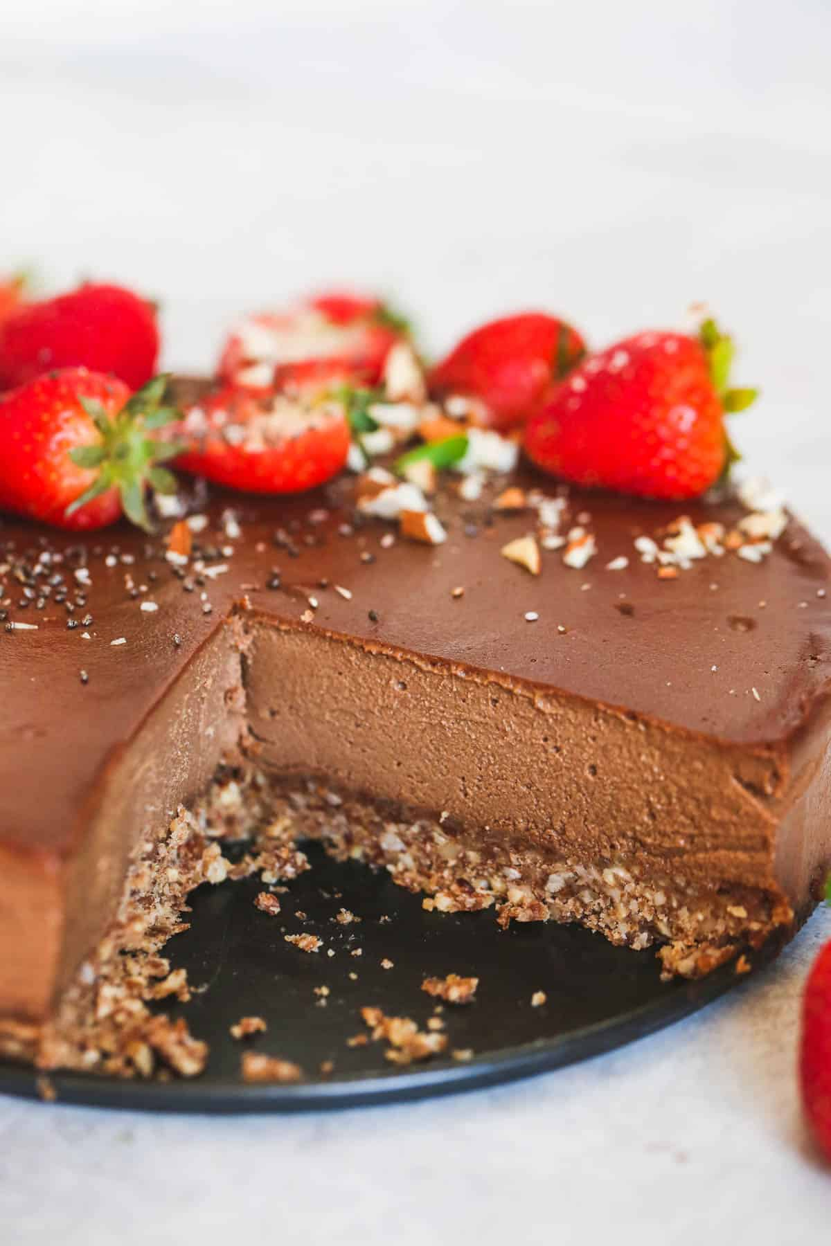 The most delicious vegan chocolate cheesecake decorated with strawberries