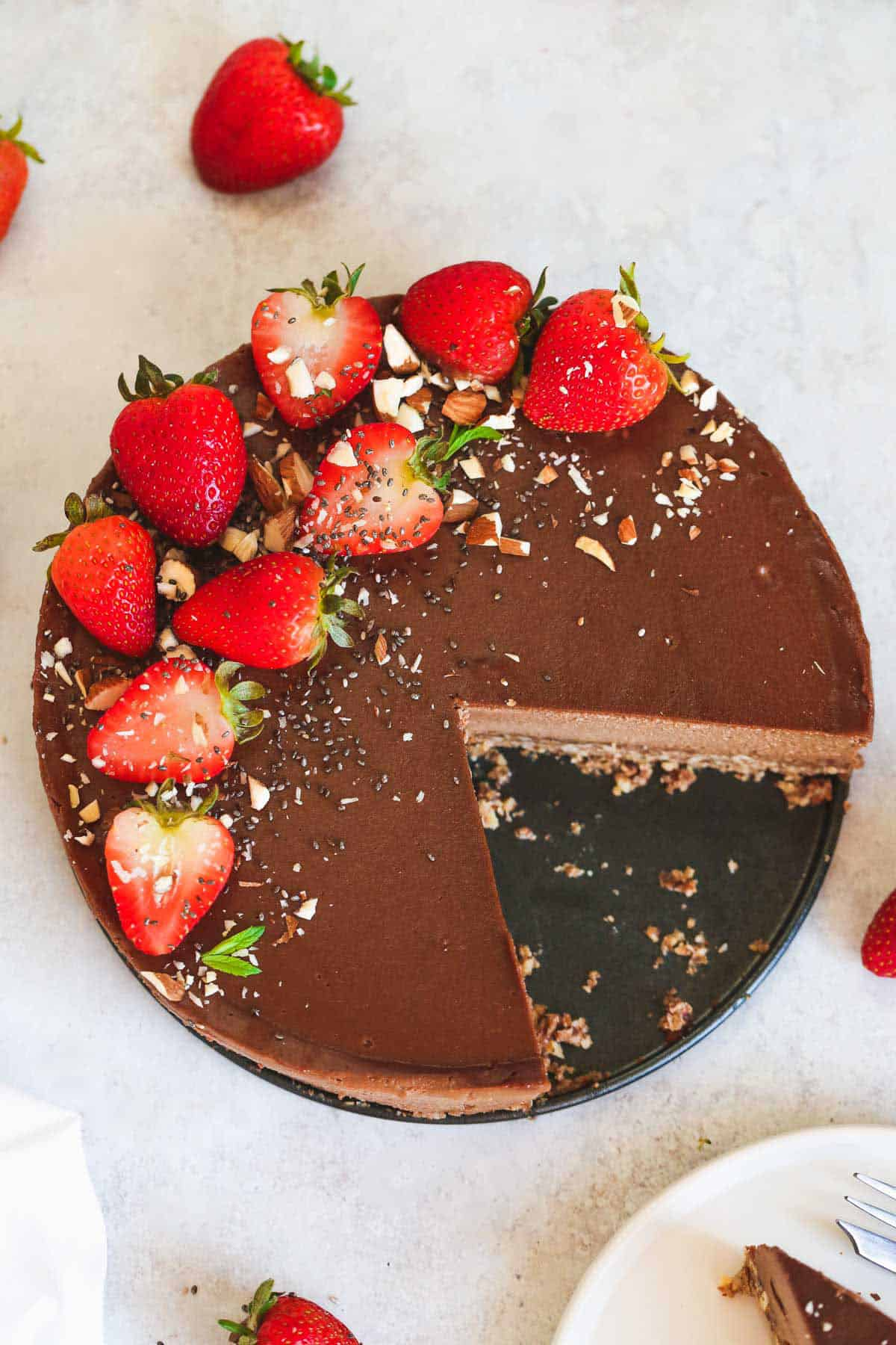 Vegan chocolate cheesecake with strawberries on top