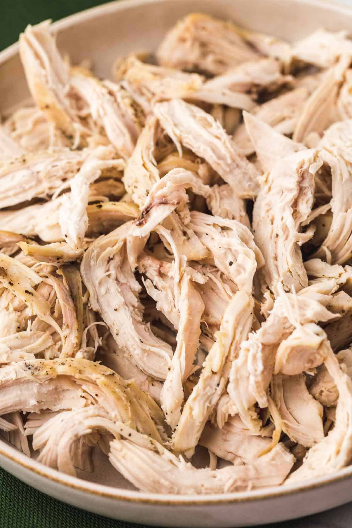 Shredded chicken on a white plate