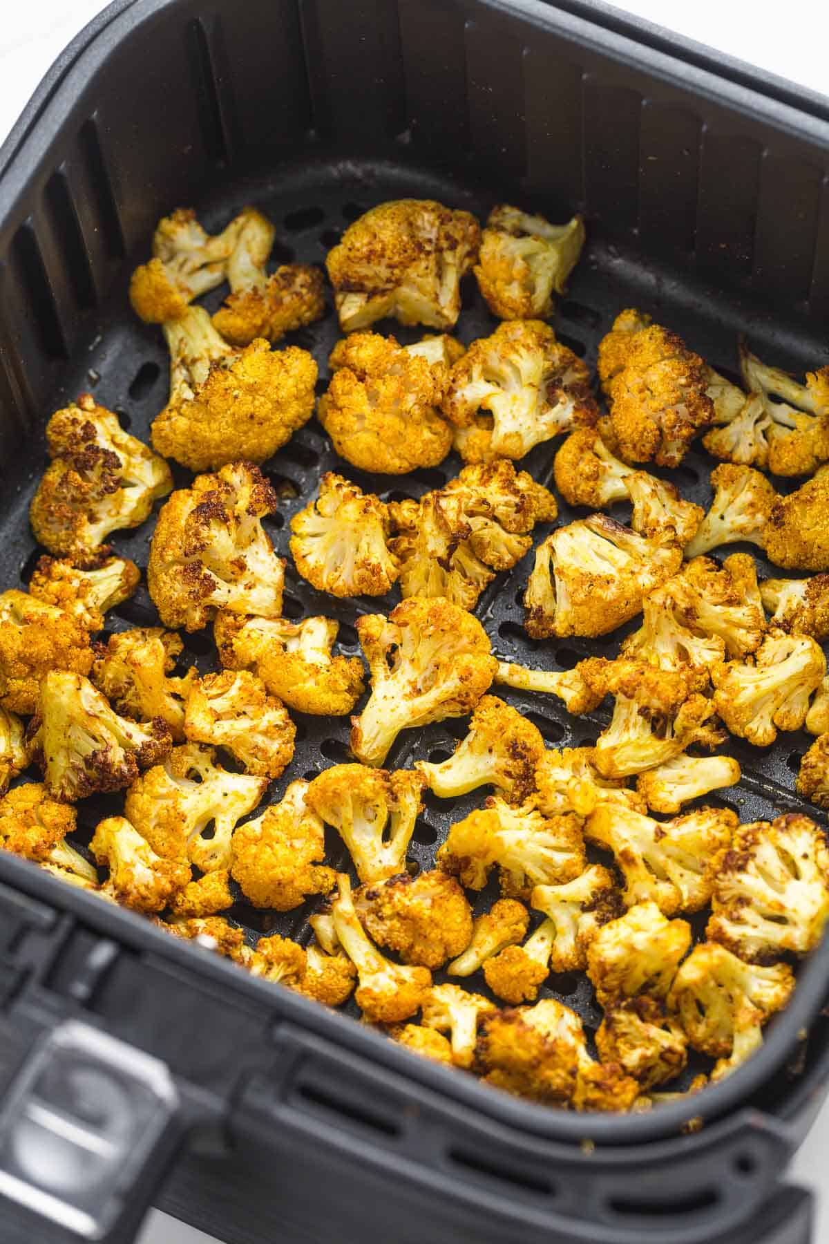 Crispy Air fried cauliflower in an air fryer basket