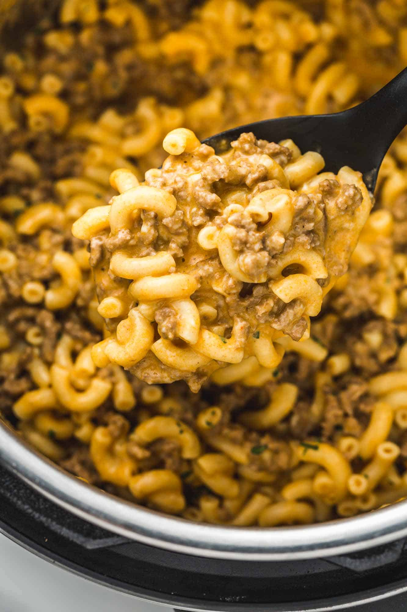 The rich and creamy texture of Hamburger Helper shown on a serving spoon