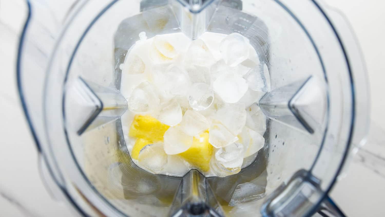 Pina colada recipe ingredients in a blender jug