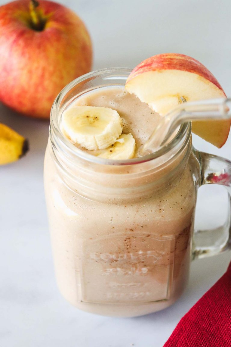 Apple banana smoothie served in a large glass jar, with a glass straw