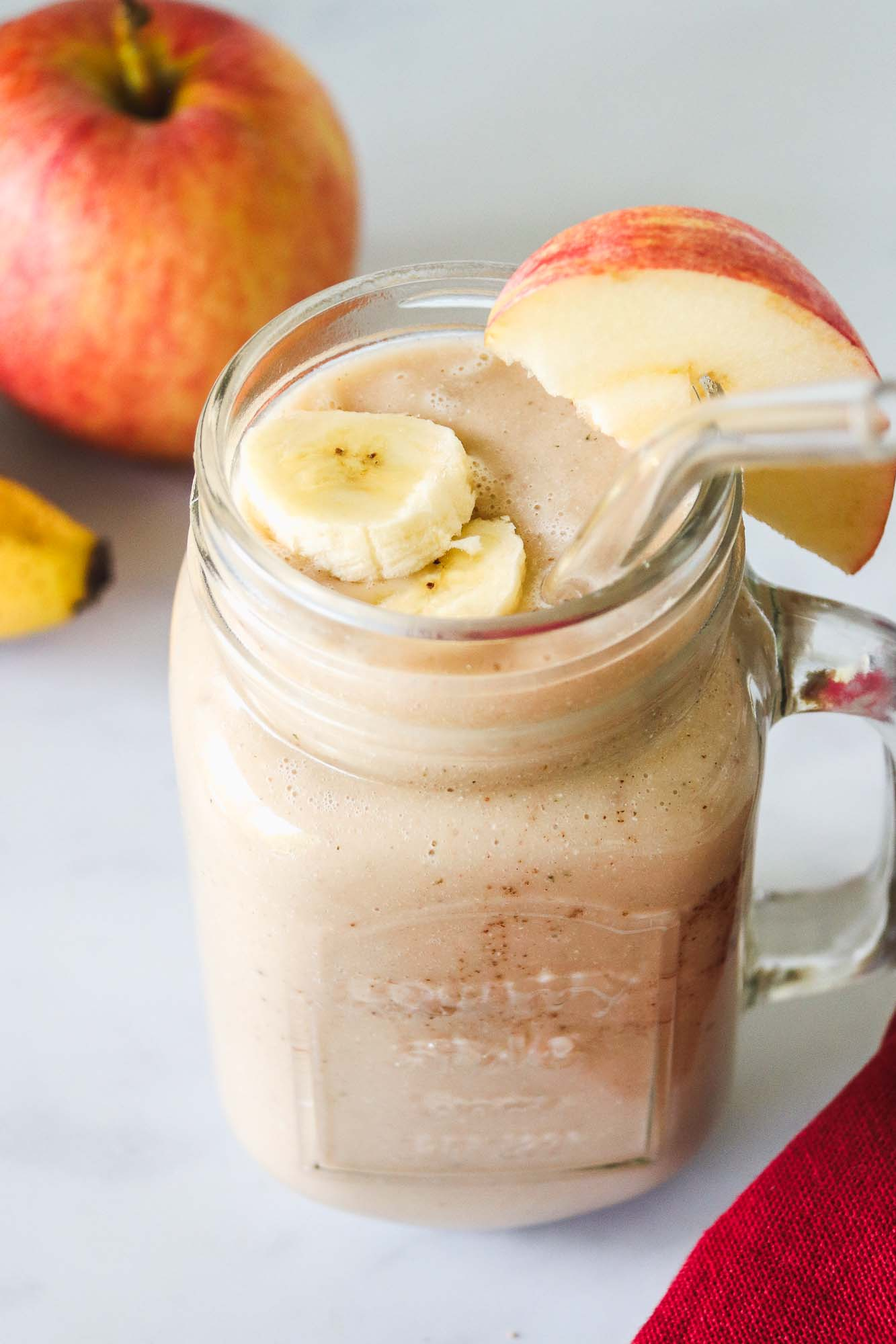 Apple Banana Smoothie served with apple and banana slices